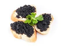 Małe kanapki z czarnym kawiorem Obrazy Stock