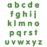 Małego listu tekst zielona trawa Fotografia Stock