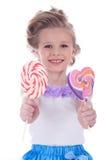 Małej dziewczynki oferty dwa lizaki Obraz Stock