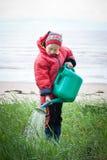 Małej dziewczynki ogrodniczka Zdjęcie Stock