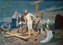 10ma estación de la cruz - pelan a Jesús de su ropa Imagen de archivo libre de regalías
