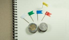 Mała flaga i moneta Obrazy Stock