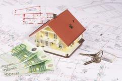 Ma maison et argent images stock