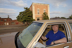 A ma sat in his car, Mississippi. A man sat in his car with a grumpy expression, Mississippi Royalty Free Stock Images