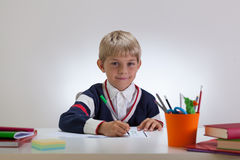 Mała studencka robi praca domowa Obrazy Royalty Free