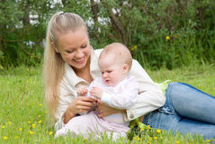 Ma with tot meadow . Royalty Free Stock Image