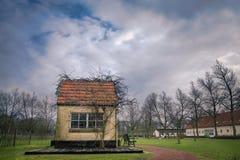 Mały bajka dom z chmurnym niebem Obraz Stock