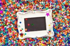 Mały chalkboard na confetti Obrazy Royalty Free