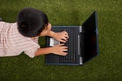 mały do laptopa dziecka Fotografia Stock