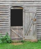Mały drzwi w starej drewnianej stajni Fotografia Royalty Free