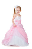 Mała dziewczynka w wspaniałej todze odizolowywającej na biel Obraz Stock