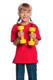 Mała dziewczynka z dumbbells Zdjęcia Royalty Free