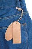 Maak etiketten op jeans schoon Stock Foto's