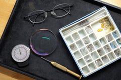 Maal de lens in het oogglas stock afbeelding