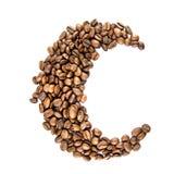 Maan van koffiebonen die op wit worden geïsoleerdf Stock Foto's