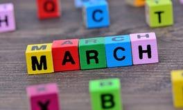 Maart-woord op lijst stock afbeelding