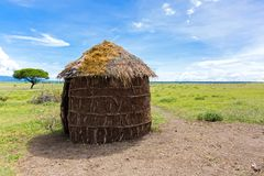 Maasai 's shelter, circular shaped thatch house made by women in Tanzania, East Africa. Maasai 's shelter, circular shaped thatch house made by royalty free stock photos