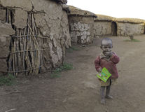 Maasai baby with candy. Poverty and dirt in the Maasai village in Kenya. Tourists are giving away candy for children to eat.The only permission that I have to Royalty Free Stock Images