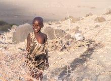 Maasai boy. ARUSHA REGION, TANZANIA - OCTOBER 15, 2015: Happy Maasai boy close to Lake Natron and Ol Doinyo Lengai (Mountain of God in the Maasai language) stock photography