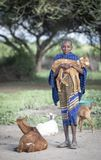 Maasai boy holding a baby goat royalty free stock images