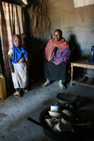 Maasai family inside their huts, a black woman and children. Stock Image