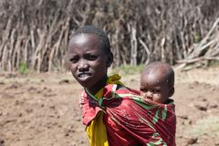 Maasai girl with baby, Tanzania royalty free stock images