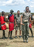 Maasai with group of tourists Stock Photo