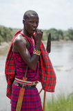 Maasai Man. A maasai warrior dressed in traditional clothes with his spear Royalty Free Stock Image