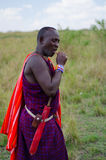 Maasai Man. A maasai warrior dressed in traditional clothes with his knife Royalty Free Stock Images