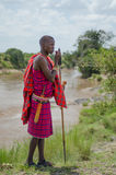 Maasai Man. A maasai warrior dressed in traditional clothes with his spear Stock Photos