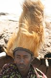 Maasai man, warrior, male lion mane on head, Tanzania royalty free stock photo