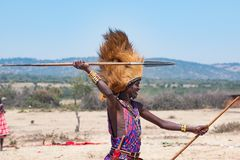 Maasai man, warrior, typical garb and male lion mane on head, spear in hand, Tanzania stock images
