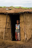 Maasai child near traditional hut Stock Images