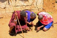 Maasai men lighting fire, Kenya Royalty Free Stock Photography