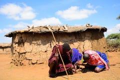 Maasai men lighting fire, Kenya Royalty Free Stock Photo