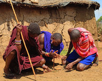 Maasai men lighting fire, Kenya Stock Photo
