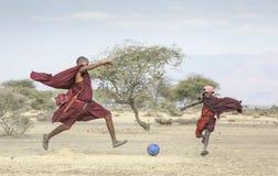 Free Maasai Men Playing Soccer Stock Images - 159038504