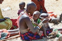 Maasai mother playing with baby, Tanzania stock image