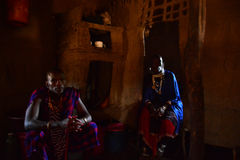 Maasai people in their traditional house with traditional clothing safari Tanzania Stock Image