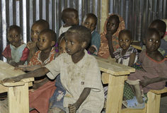 Maasai school. Children sitting on wooden benches in a tin school building in the village of maasai Royalty Free Stock Image