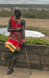 Maasai with smile. Maasai with steak in kenya. May 2014. it,s a vertical picture in cloudy day Stock Image