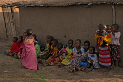 MAASAI VILLAGE, KENYA - JANUARY 2 2015. Children of maasai tribe seat on the ground near their houses. Problems of African children are very sharp nowadays and Royalty Free Stock Images