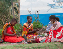 Maasai women makes traditional necklace Stock Photo
