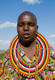 Maasai women together singing ritual songs in traditional dress. Stock Photos