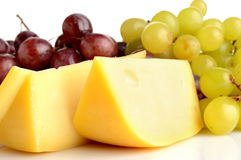Maasdam cheese. And grapes on white background Royalty Free Stock Photos
