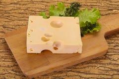 Maasdam cheese brick stock photos