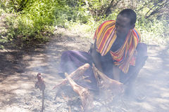 Maasi male cooking ceremonial meal, Ngorongoro Conservationa Are Stock Photography