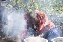 Maasi man cooking ceremonial meal, Ngorongoro Conservationa Area Royalty Free Stock Image