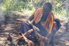 Maasi warrior cooking ceremonial meal, Ngorongoro Conservationa Royalty Free Stock Photography