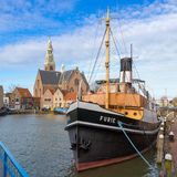 Maassluis, Netherlands, February 11, 2018: Furie steam sail ship. Furie steam sail ship in front of the Great Church in Maassluis Royalty Free Stock Photography